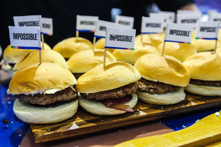 Image: Impossible Burgers sit on a tray on day five of the 2nd China International Import Expo at the National Exhibition and Convention Center