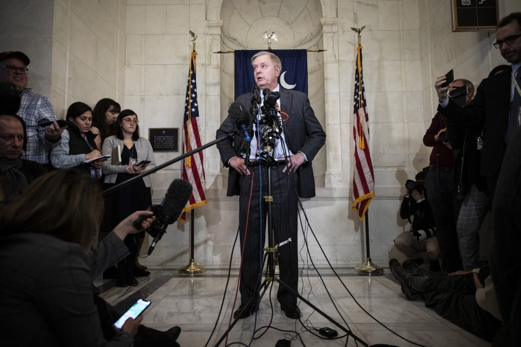 Image: Sen. Lindsey Graham, R-S.C., speaks to reporters outside his office at the Capitol on Dec. 18, 2019.