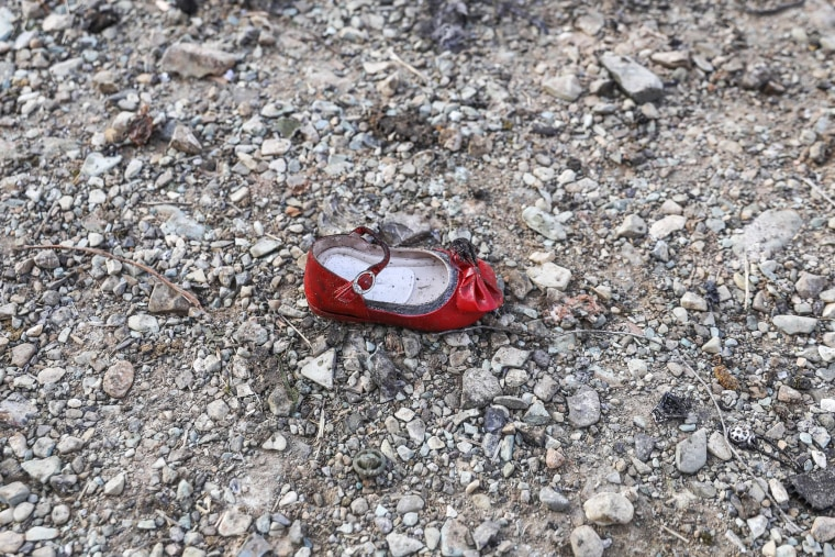 Image: A child's shoe at the scene of a Ukrainian airliner that crashed shortly after take-off near Imam Khomeini airport in the Iranian capital Tehran