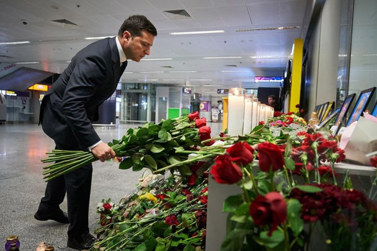 Image: Ukraine's President Volodymyr Zelensky placing flowers at a memorial for the victims of the Ukraine International Airlines Boeing 737-800 crash in the Iranian capital Tehran, at the Boryspil airport outside Kiev