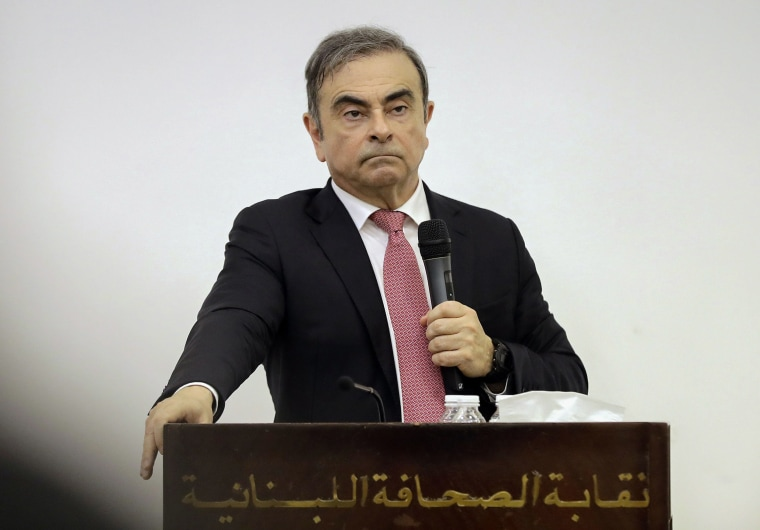 Image: Former Renault-Nissan boss Carlos Ghosn addresses a large crowd of journalists on his reasons for dodging trial in Japan where he is accused of financial misconduct, at the Lebanese Press Syndicate in Beirut