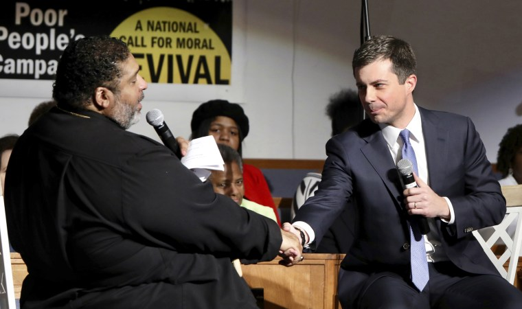 Image: Former Mayor Pete Buttigieg shakes hands with Rev. Dr. William J. Barber at the Greenleaf Christian Church in N.C. on Dec. 1, 2019.