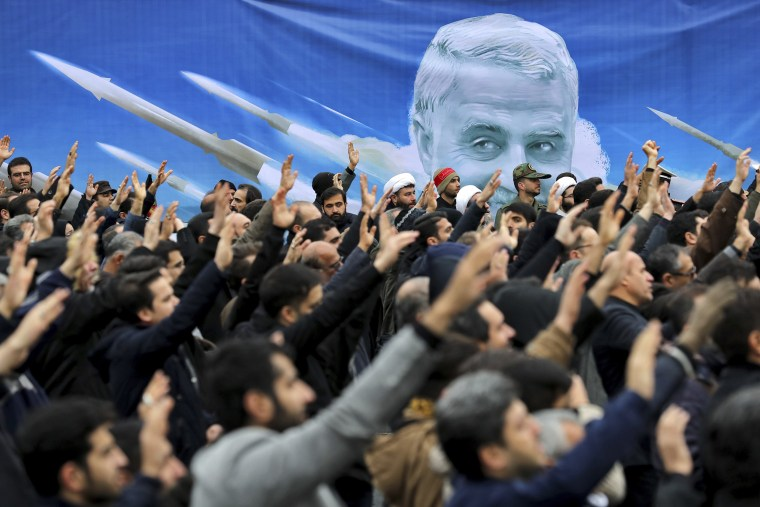 """Protesters demonstrate over the U.S. airstrike in Iraq that killed Iranian Revolutionary Guard Gen. Qassem Soleimani in Tehran, Iran, on Jan. 4, 2020. Iran vowed \""""harsh retaliation\"""" for the U.S. airstrike near Baghdad's airport that killed Tehran's top general and the architect of its interventions across the Middle East, as tensions soared in the wake of the targeted killing."""
