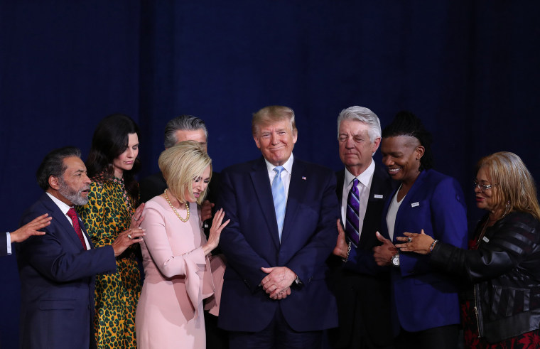 "Faith leaders pray over President Donald Trump during an ""Evangelicals for Trump"" campaign event at the King Jesus International Ministry in Miami on Jan. 3, 2020."