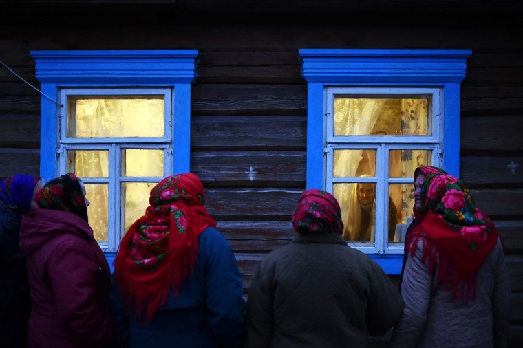 Villagers celebrate Kalyady, is an ancient pagan holiday originally celebrated on winter solstice, in the village of Danilevichy, Belarus on Jan. 7, 2020. Kalyady. Dressed-up people walk from house to house singing, dancing, eating and drinking with their neighbors.