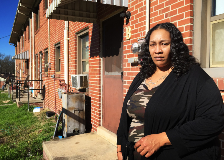 Sequena Pettiford outside of her family's apartment at McDougald Terrace in Durham, N.C. Pettiford's 12-year-old daughter, and at least 15 other residents of the housing complex, were identified with elevated levels of carbon monoxide since late November.