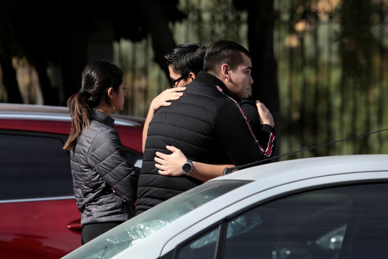 Image: People react outside a private school after a boy shot a teacher and wounded several students, in Torreon