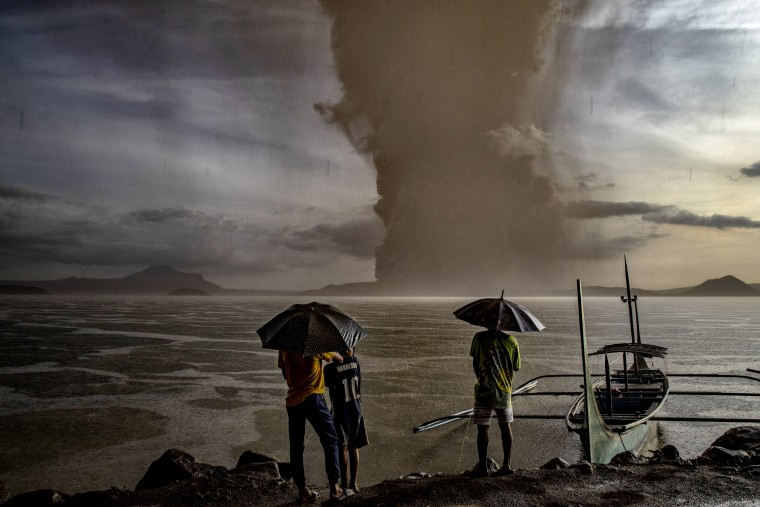 Image: Residents look at Taal Volcano eruption near Talisay in the Philippines on Jan. 12, 2020.