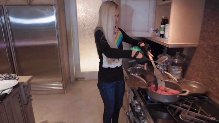 """Paris Hilton may not have the right utensils, but she's cooking up a storm on her new Youtube show, """"Cooking with Paris."""""""