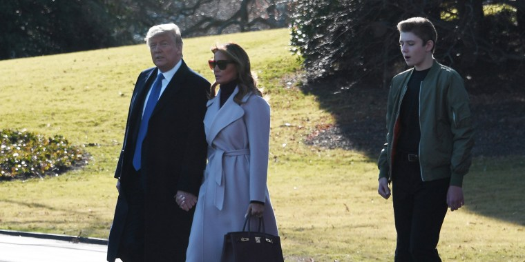 Image: President Donald Trump, wife Melania and son Barron leave for the weekend.