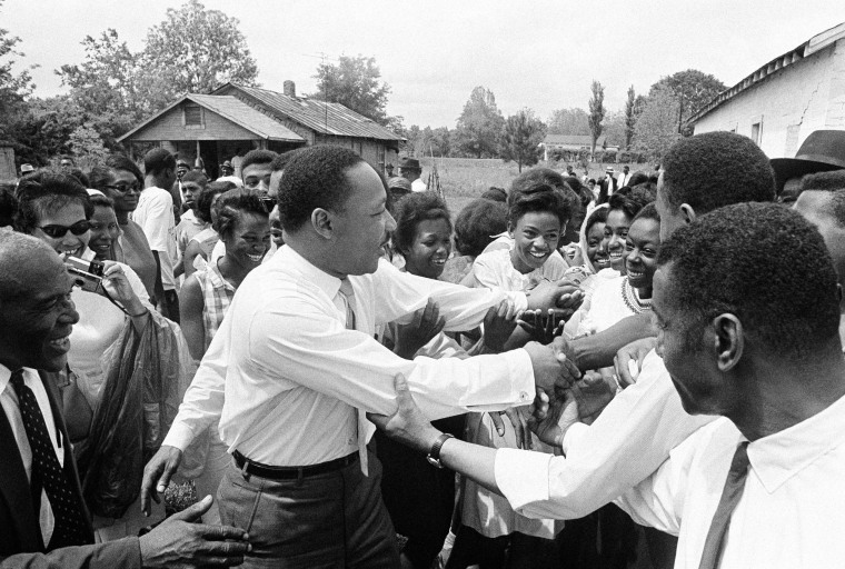 Image: King shakes hands with a group of girls after addressing a political rally in Lisman, Alabama