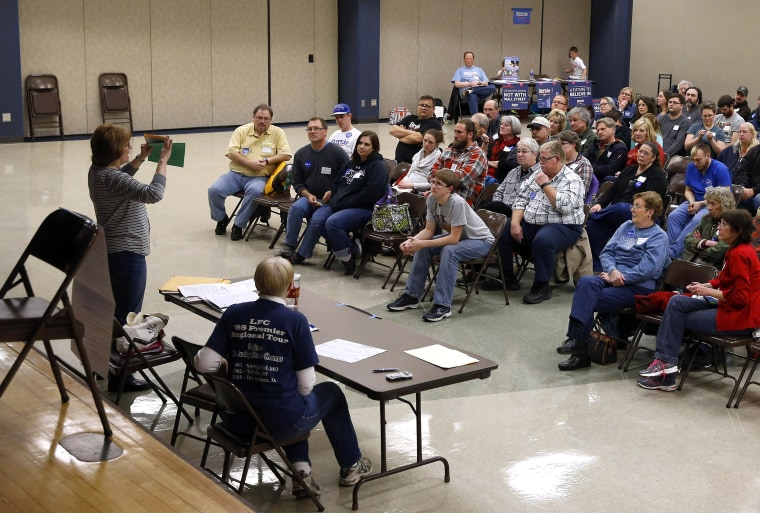 Voters listen to instructions during a Democratic Party caucus in Nevada, Iowa, on Feb. 1, 2016.