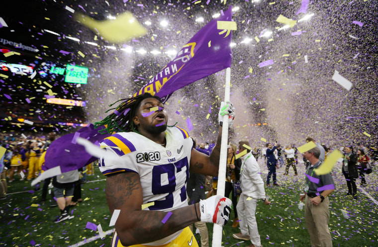 Image: LSU Tigers defensive end Glen Logan (97) celebrates after the LSU Tigers defeated the Clemson Tigers in the College Football Playoff national championship game at Mercedes-Benz Superdome