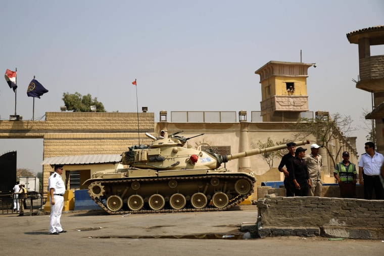 Egyptian security forces stand guard outside one of the entrances to the Tora prison in Cairo in 2015.