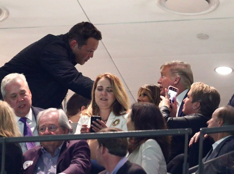Image: Actor Vince Vaughn greets first lady Melania Trump and President Donald J. Trump in the College Football Playoff national championship game between the Clemson Tigers and the LSU Tigers at Mercedes-Benz Superdome.