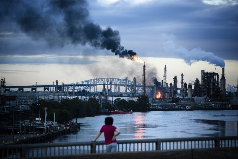 Image: Flames and smoke rise after a series of explosions at the Philadelphia Energy Solutions Refining Complex on June 21, 2019.