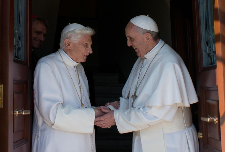 Image: Pope emeritus Benedict XVI, left, is welcomed by Pope Francis as he returns at the Vatican from the pontifical summer residence of Castel Gandolfo,