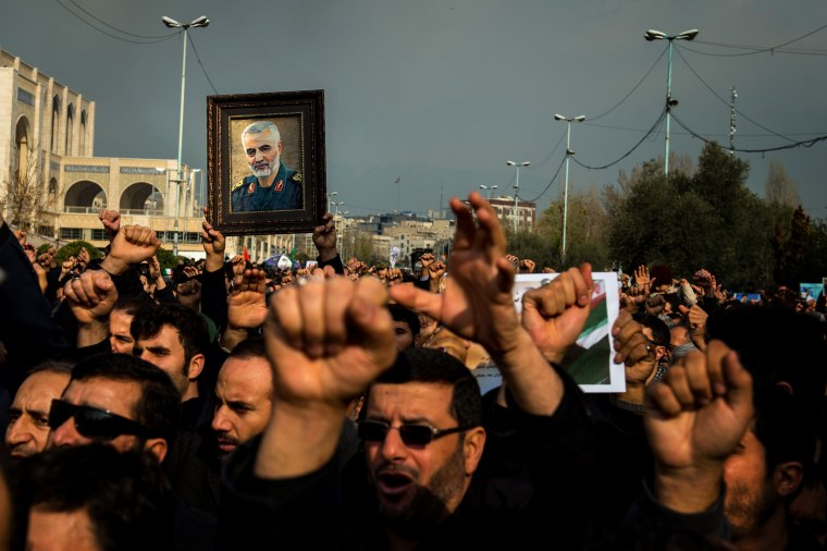 Image: Protesters hold a photo of Iranian General Qassem Soleimani during a demonstration in Tehran on Jan. 3, 2020.