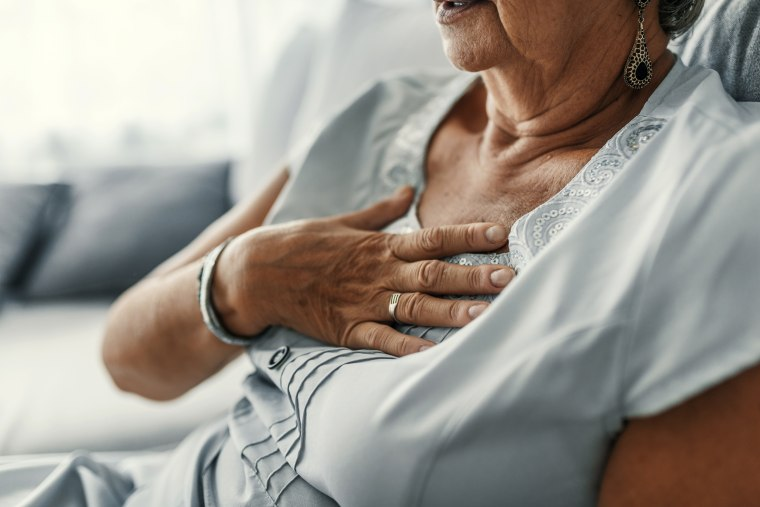 Image: Female with chest pain. Senior woman suffering from heartburn or chest discomfort symptoms. Acid reflux or Gastroesophageal reflux disease (GERD) concept