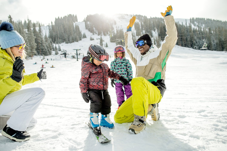 Image: Family having fun during the winter at a ski resort on a nice day.