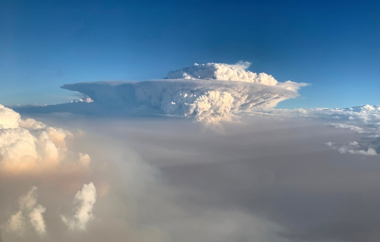 Image: Pyrocumulonimbus cloud formation is seen from a plane as bushfires continue in New South Wales