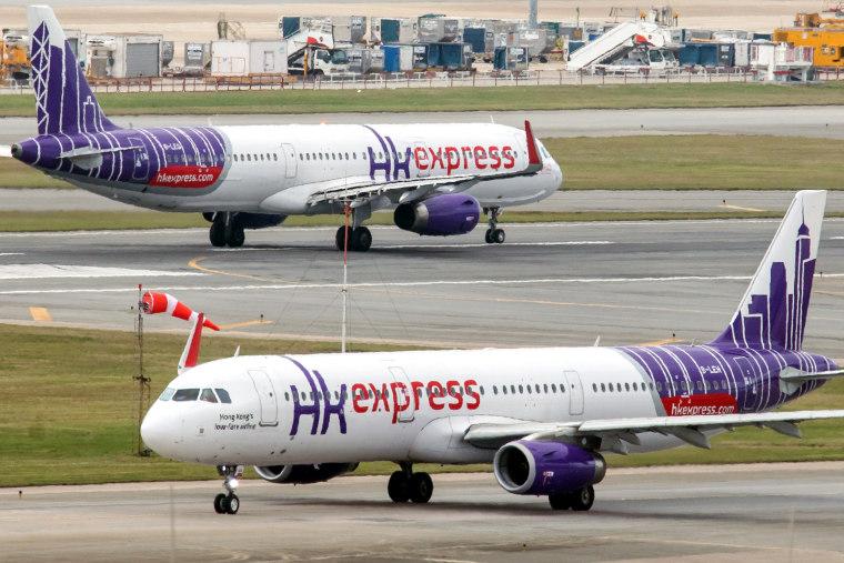 A Hong Kong Express aircraft taxis at Hong Kong International Airport.