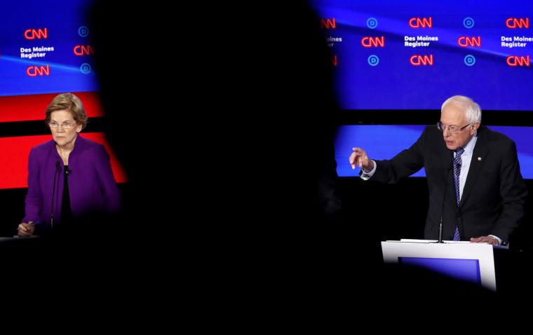 Image: Sen. Elizabeth Warren, D-Mass., and Sen. Bernie Sanders, I-VT, participate in a Democratic presidential debate in Des Moines, Iowa, on Jan. 14, 2020.