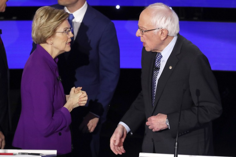Image: Democratic 2020 U.S. presidential candidate Senator Elizabeth Warren chats with Senator Sanders at the end of the seventh Democratic 2020 presidential debate at Drake University in Des Moines, Iowa, U.S.