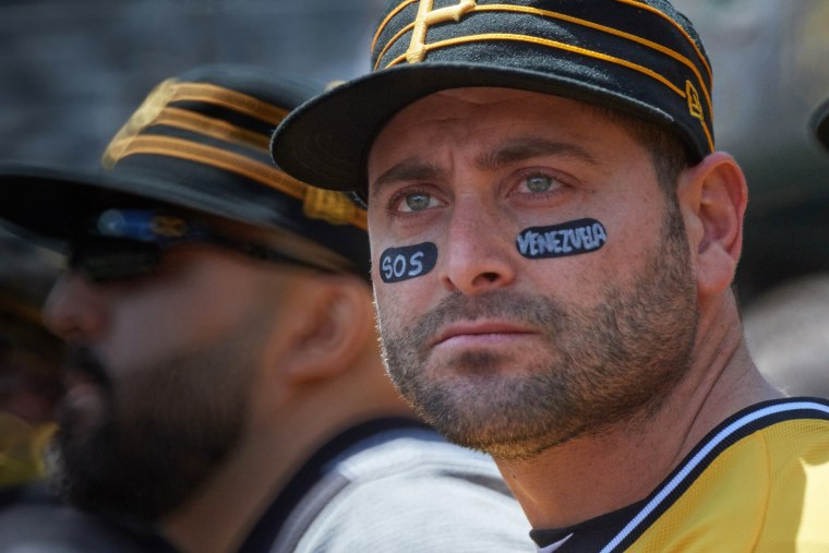 Venezuelan catcher Francisco Cervelli wears a message of support for his home country in his eye black during a game in 2017.