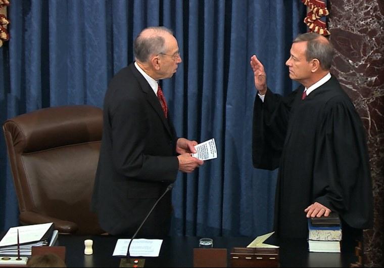 Image: President Pro Tempore of the Senate Sen. Chuck Grassley, R-Iowa., swears in Supreme Court Chief Justice John Roberts