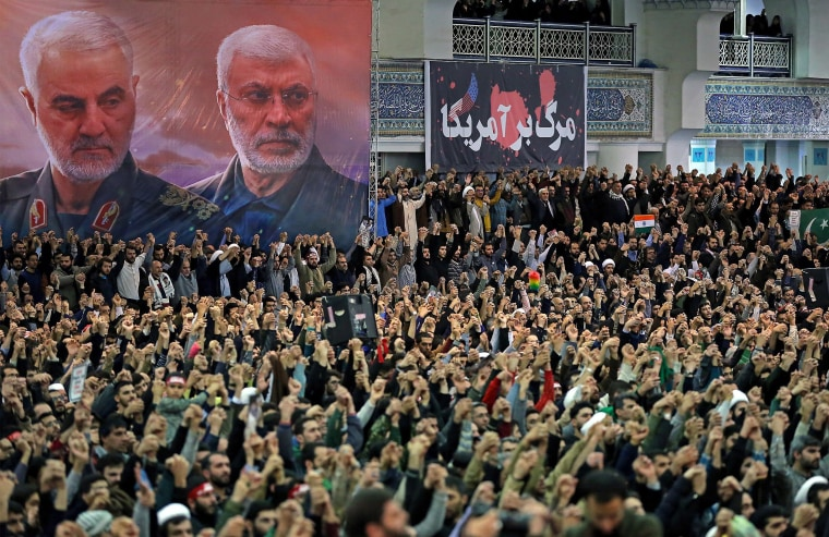 Image: Iranians chanting slogans during Friday prayers in the capital Tehran, under portraits of slain Iranian commander Qasem Soleimani and Iraq's Hashed al-Shaabi military network deputy chief Abu Mahdi al-Muhandis