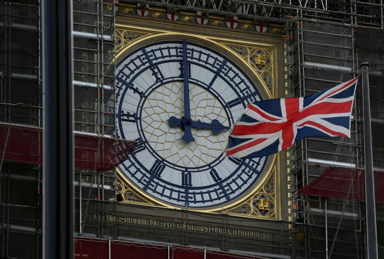 Image: FILE PHOTO: British Union Jack flies in front of the clock face of the clock that houses the Big Ben bell in London