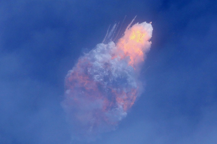 Image: A SpaceX Falcon 9 rocket engine self-destructs after jettisoning the Crew Dragon astronaut capsule during an in-flight abort test after lift of from the Kennedy Space Center in Cape Canaveral