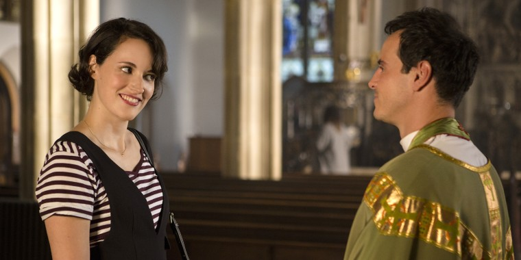"""The characters played by Phoebe Waller-Bridge and Andrew Scott listen to each other in the hit series """"Fleabag."""""""