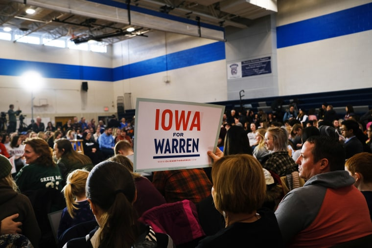 Image: Supporters listen as Democratic presidential candidate Sen. Elizabeth Warren (D-MA) speaks during a town hall event at a school on Jan. 19, 2020 in Des Moines, Iowa.