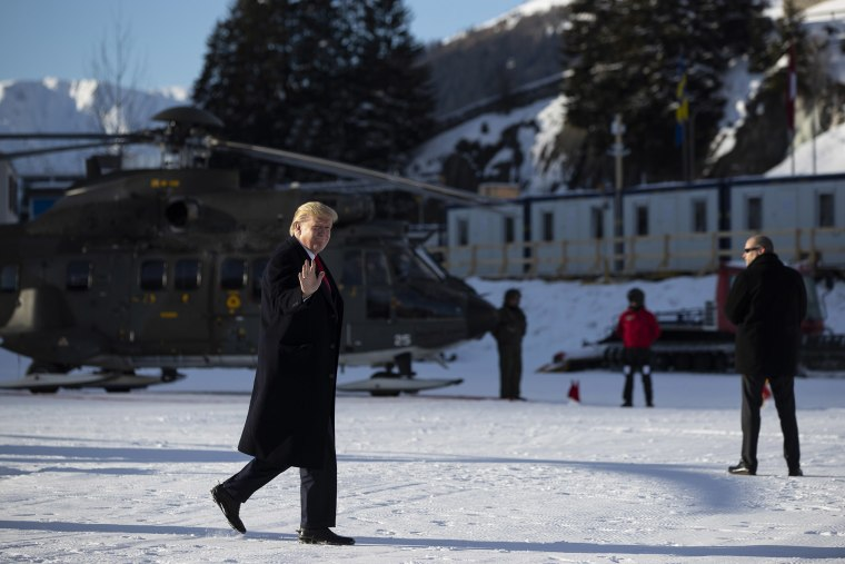 Image: President Donald Trump waves as he arrives in Davos, Switzerland on Marine One