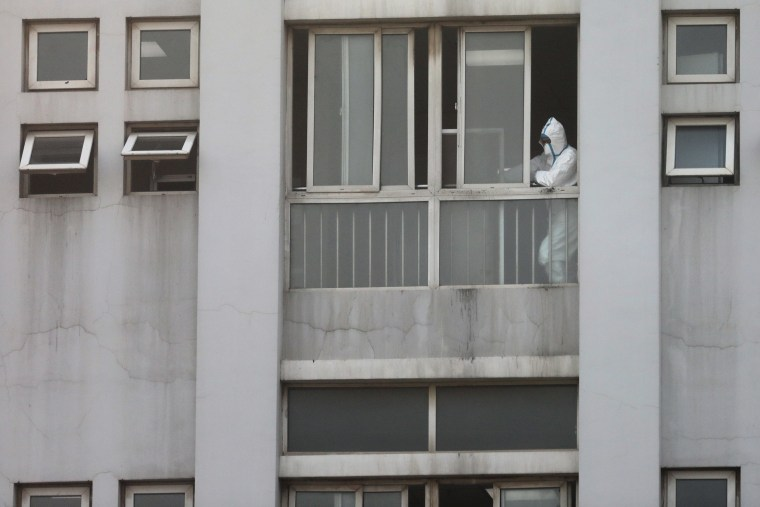 Image: A member medical staff by a window at the Jinyintan hospital, where the patients with pneumonia caused by the new strain of coronavirus are being treated, in Wuhan, Hubei province, China