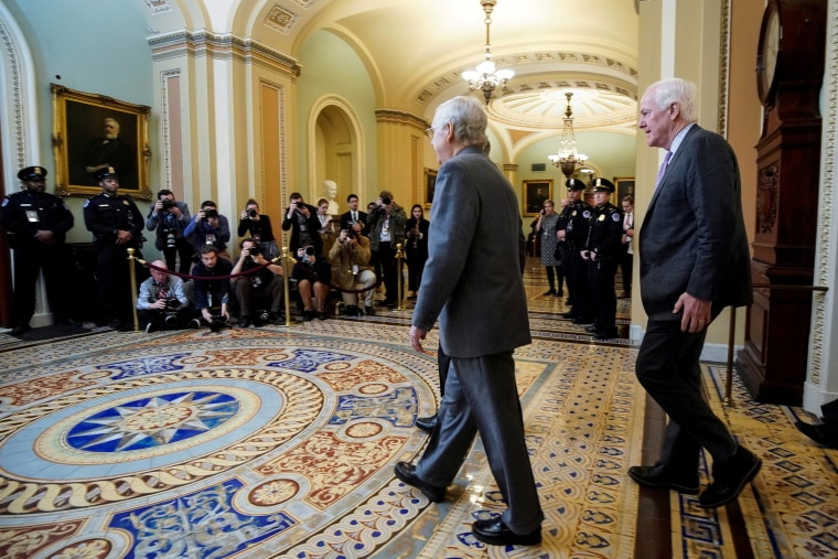 Image: FILE PHOTO: Senate Majority Leader McConnell and Senator Cornyn arrive for the beginning of the Trump impeachment trial in Washington