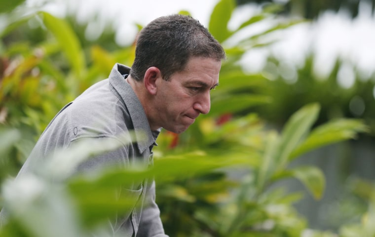 Glenn Greenwald, the blogger and journalist who broke the U.S. NSA surveillance scandal, reacts during an exclusive interview with Reuters in Rio de Janeiro