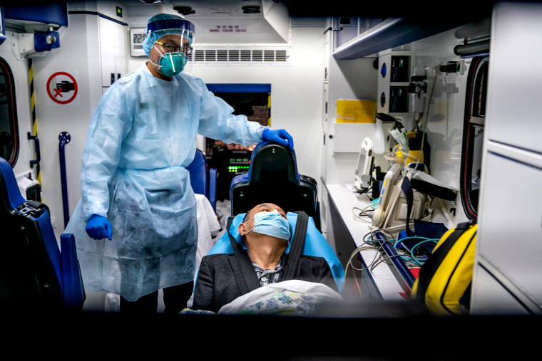 Image: A patient is transferred by ambulance to the Infectious Disease Center in Hong Kong on Jan. 22, 2020. Countries including Hong Kong, the United States, Thailand, Japan, Taiwan and South Korea have reported cases of the coronavirus.