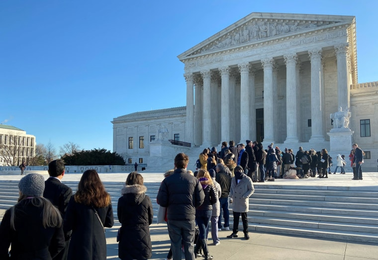 Image: People line up outside the Supreme Court ahead of oral arguments in a case from Montana on religious rights and school choice