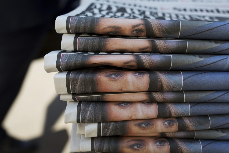 A stack of Evening Standard newspapers with photos of Meghan Markle in London