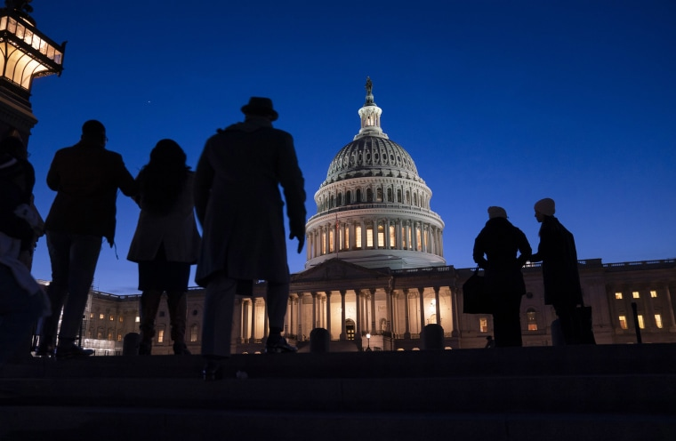 Image: Night falls on the Capitol, Wednesday evening, Jan. 22, 2020, during in the impeachment trial of President Donald Trump.