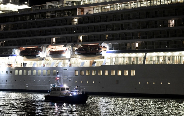 Image: Local authorities and the U.S. Coast Guard search for a person who reportedly went overboard from Royal Caribbean's Oasis of the Seas cruise ship in Puerto Rico on Jan. 22, 2020.