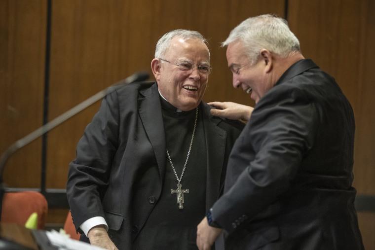 Archbishop Charles J. Chaput, left, embraces his successor Archbishop-elect Nelson J. Perez in Philadelphia on Jan. 23, 2020.