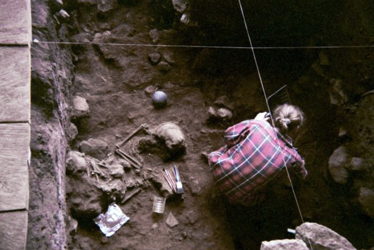 A researcher excavates the ancient bones at the Shum Laka rock shelter, which holds the remains of children who lived about 8,000 and 3,000 years ago.