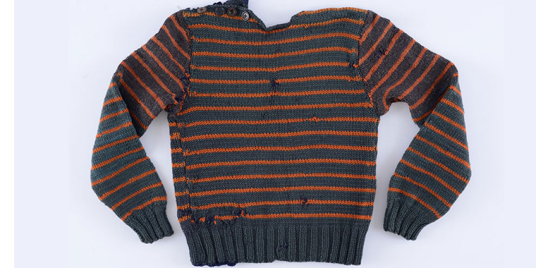 a sweater stolen by Mottie Alon from under the noses of Auschwitz guards in January 1945.