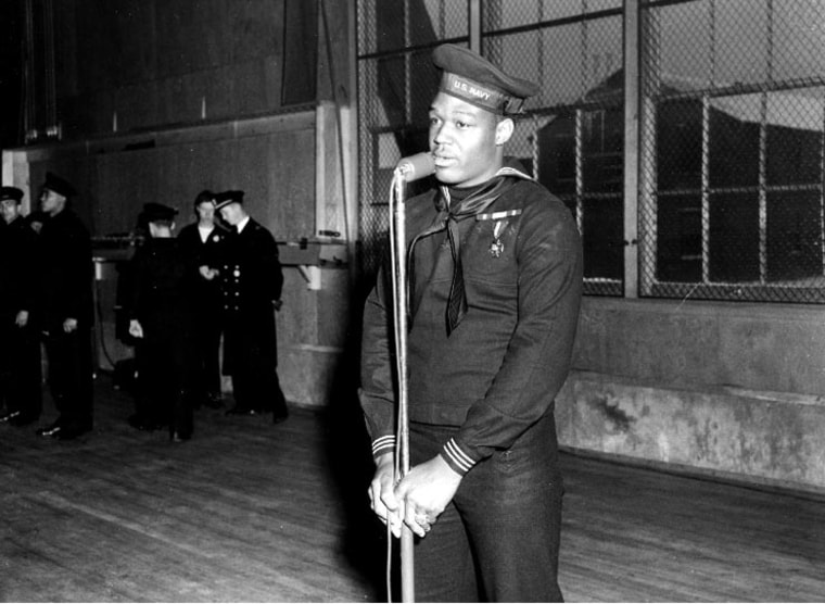 U.S. Navy Mess Attendant First Class Doris Miller speaking during his war bond tour stop at the Naval Training Station, Great Lakes, Ill. on Jan. 7, 1943.