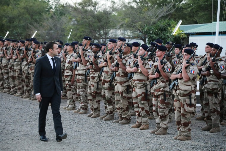 French president Emmanuel Macron reviews the troops as he arrives at the Barkhane tactical command center