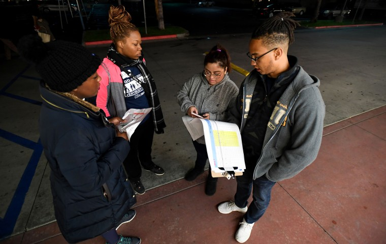 Image: Volunteers walk the streets of Long Beach for the 2020 homeless count